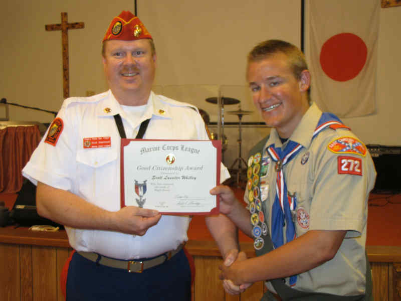 Photo of Adjutant/Paymaster and fellow Eagle Scout Scott Shermeyer presenting an Eagle Scout Good Citizenship Award to Eagle Scout Scott Lassiter Whitley at his court of honor.